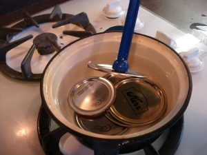 Remove hot lids from the hot water