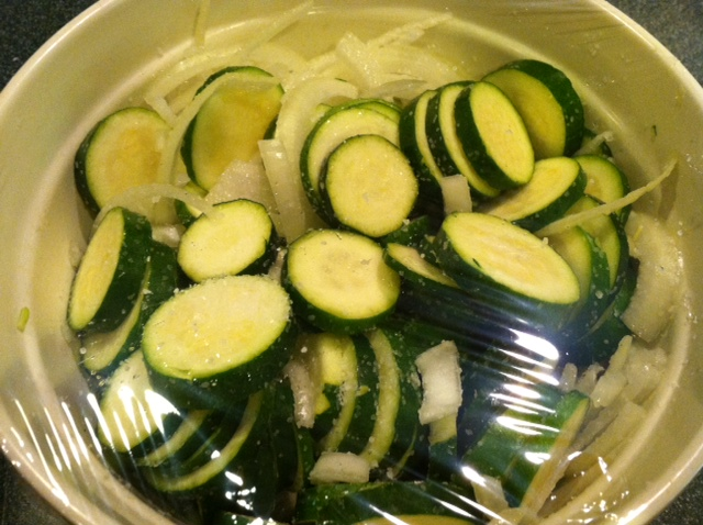 Salted Cucumbers with onions to draw out the moisture to receive the vinegar and spices.