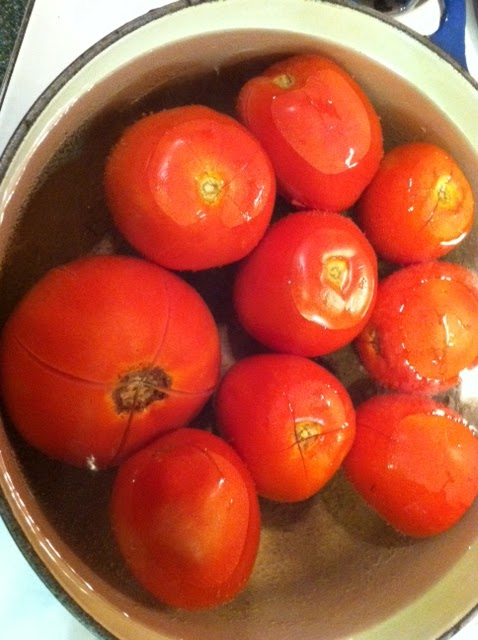 Tomatoes in simmering water